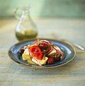 Greek peasant's salad on blue plate; olive oil