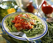 Spinach pasta with tomatoes and rosemary