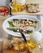 Marinated herrings in cider; radish sandwiches; beer