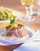 Pork fillet with root vegetables in cream & cognac sauce