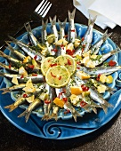 Marinated sardines with lemons, herbs and chili rings