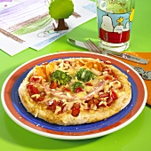 Pizza with ham and vegetables for children