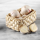 Chinese garlic in basket, one halved