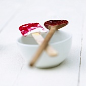 Spatula and kitchen spoon with remains of berry compote
