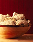 Wholemeal rolls in wooden bowl