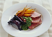 Corned beef with parsley sauce and fried vegetables