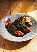 Red mullet in vine leaves with white bread