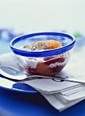 Muesli with berry puree, orange and sunflower seeds