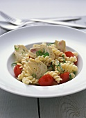 Pasta salad with artichoke hearts and cherry tomatoes