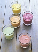 Various yoghurt drinks with fruit and avocado