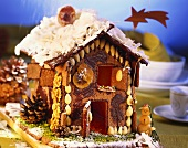 Gingerbread house with chocolate, nuts and almonds