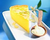 Piece of lemon tart with amaretto cream