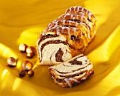 Iced nut cake on yellow background