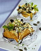 Baked potatoes with herb butter and pumpkin seeds