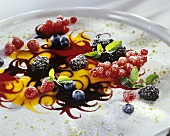 Fruit sauce with berries and icing sugar