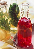 Two bottles of herb oil & one bottle of raspberry vinegar
