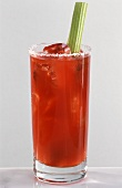 Bloody Mary in long drink glass, garnished with stick of celery
