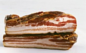 Two pieces of smoked streaky bacon