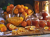 Orange marmalade in jars, Seville oranges, orange slices