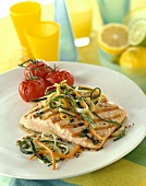 Grilled salmon trout with grilled tomatoes on a plate