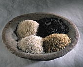 Four different types of rice in a bowl