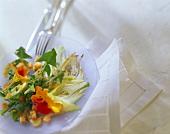 Dandelion salad with fennel and nasturtium flowers
