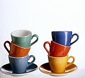 Coloured coffee cups, in a pile