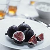 Fresh figs on a plate, one cut open