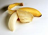 One Partially Peeled Banana