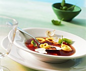 Tomato consomme with tortellini and mushrooms