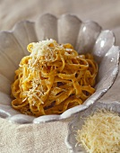 Ribbon noodles with grated cheese in a bowl
