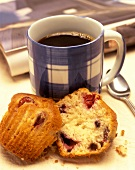 A Mug of Coffee with a Cranberry Muffin