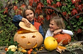 Two Girls with a Jack O' Lantern and Pumpkins for Halloween