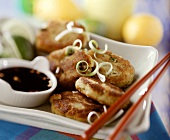 Onion burgers with sauce and chopsticks