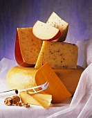 Assorted Cheeses with Cheese Knife and a Walnut