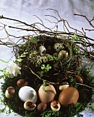 Chocolate mousse eggs laid on Easter wreath
