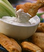 Deep-fried Buffalo chicken wings in cream cheese dip