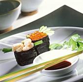 Sushi with shrimps and with salmon roe (Gunkan maki sushi)