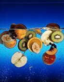 Various fruits in water (apples, kiwis, bananas etc)