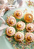 Pink sweet pastry flowers with sugar pearls on a plate