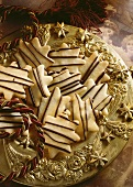 Biscuits decorated with chocolate lines on a golden plate