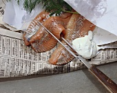 Matie fillet with dill cream on paper