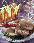 Three slices of goose liver pate on plate