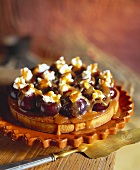Fig tartlet with cream topping and caramel