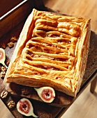 Puff pastry filled with fig, orange and nut