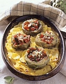 Stuffed artichoke hearts on potato gratin