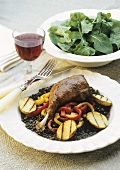 Roast duck leg with lentils and roast potatoes