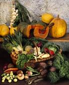 Vegetables in wicker basket, pumpkins on a wooden shelf