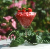 Raspberry whip with fresh raspberries in stemmed glass
