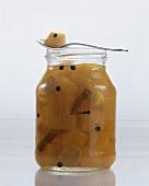 Bottled pumpkin in jar and on spoon